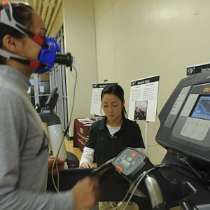 FORT CARSON, Colo. -- Spc. Alejandra Herrera, mechanic, 7th Sqaudron, 10th Cavalry Regiment, 1st Brigade Combat Team, 4th Infantry Division, is competing in the VO2 Max Competition to determine who is the fittest male and female Soldier on Fort Carson. Krys Bankard, health promotion technician, Army Wellness Center, is monitoring the test. The test  was held at the Iron Horse Sports and Fitness Center, Fort Carson, Mar. 6, 2013..(U.S. Army photo by Cpl. William Smith, 4th Inf. Div. PAO)